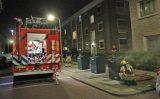 13 oktober Brandweer druk bezig met rokende container Verwoldestraat Den Haag