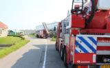 27 augustus Brandweer redt gewonde zwaan van dak van kas Raaphorstlaan Monster