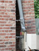 8 juni Vuilniswagen ramt woning tijdens achteruitrijden Singelstraat Delft