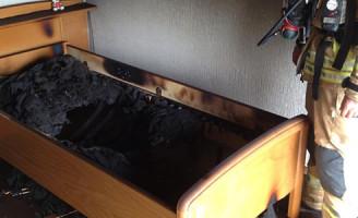 22 juli Bed in slaapkamer in brand Schiedam